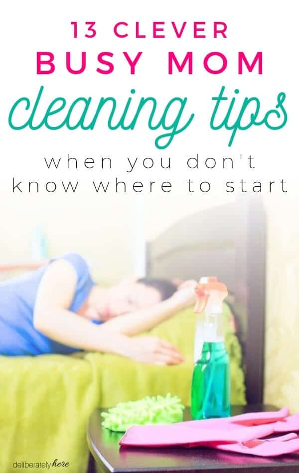 busy mom cleaning tips . exhausted mom laying on bed with cleaning supplies doesn't want to clean anymore.