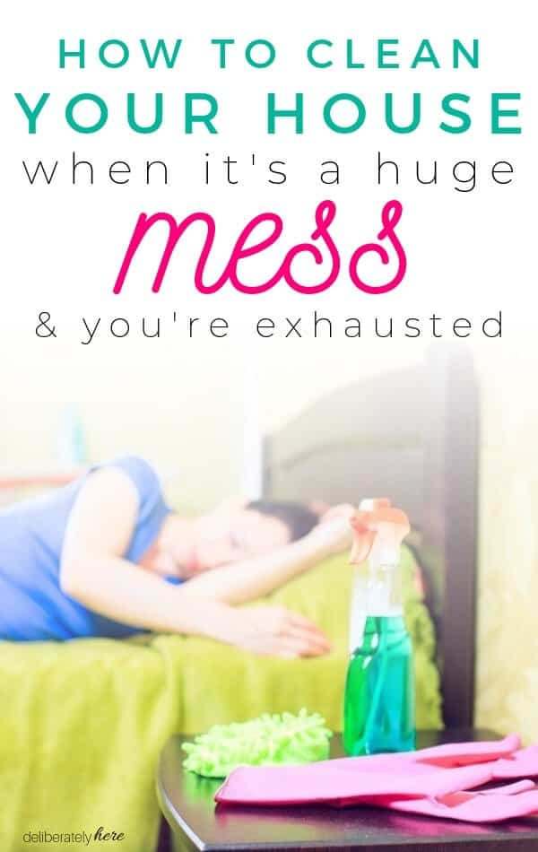 how to clean a disgusting house. woman laying in bed with cleaning supplies exhausted from cleaning a messy house.